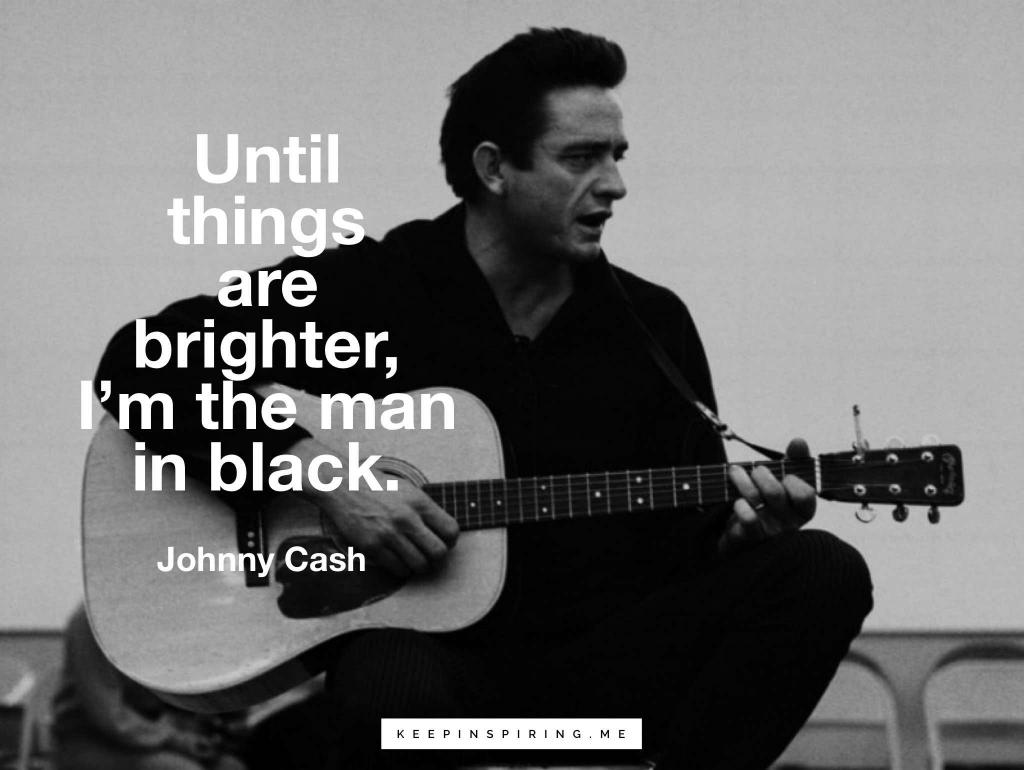 The Man in Black playing a guitar and singing Walk the Line