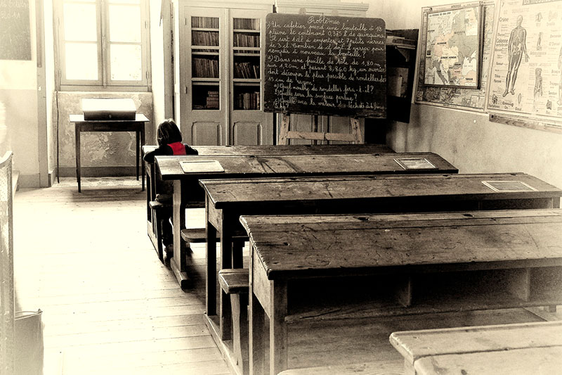Girl alone in the classroom