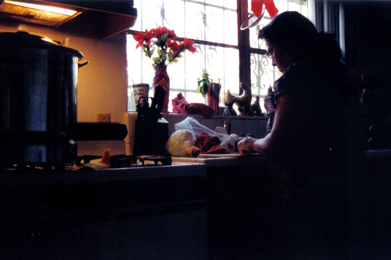 Mother preparing food in kitchen